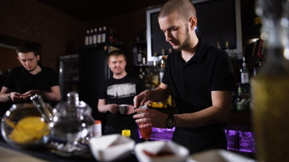 Thumbnail for Several Bartenders In Stylish Black Shirts