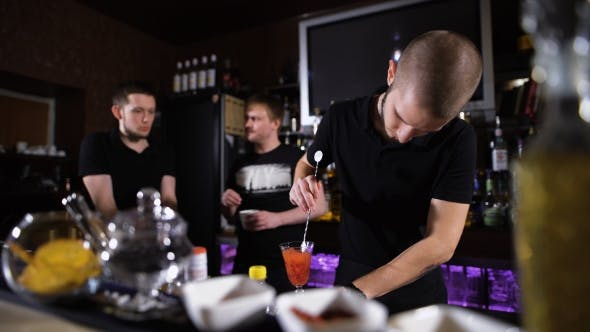 Thumbnail for Bartender Is Making Cocktail At Bar Counter, Night Club