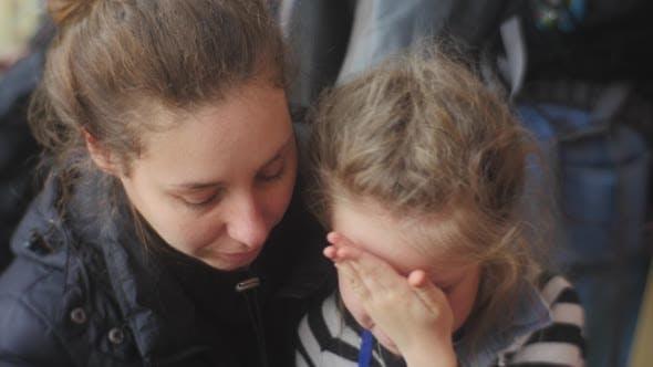 Thumbnail for Mom Kisses a Kid Forehead Kiss Girl Stops Crying