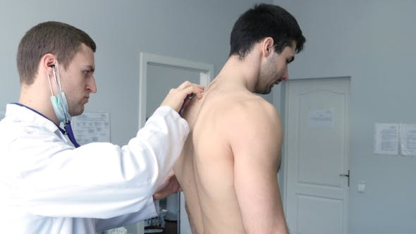 Thumbnail for Doctor Examining Back Of Young Male Patient With Stethoscope