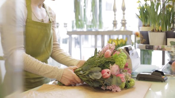 Thumbnail for Florist Woman With Flowers And Man At Flower Shop 19
