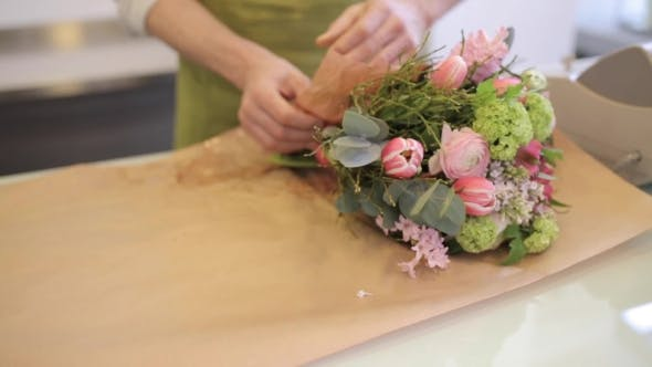 Thumbnail for Florist Wrapping Flowers In Paper At Flower Shop 11