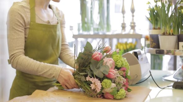 Thumbnail for Florist Woman With Flowers And Man At Flower Shop 18
