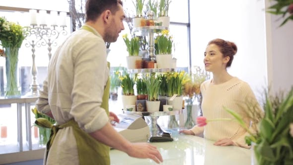 Thumbnail for Florist Showing Flowers To Woman At Flower Shop 9