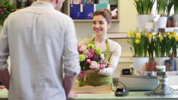 Thumbnail for Florist Woman With Flowers And Man At Flower Shop 2