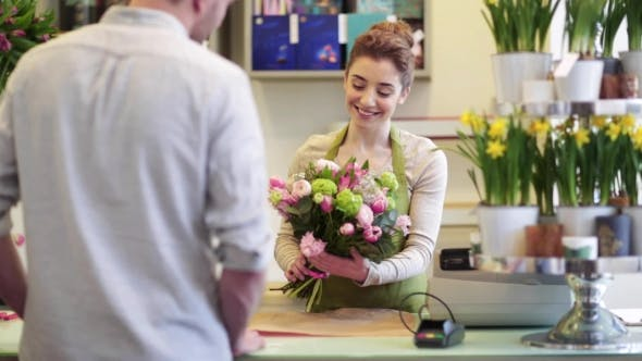 Thumbnail for Florist Woman With Flowers And Man At Flower Shop 1