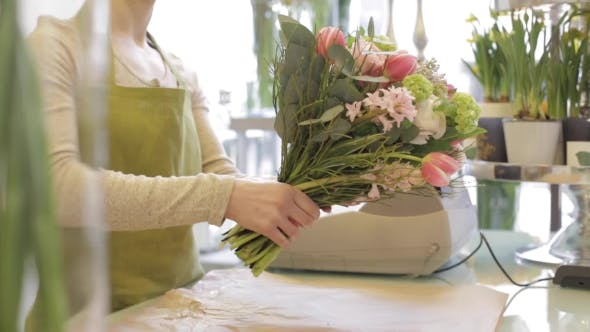 Thumbnail for Florist Wrapping Flowers In Paper At Flower Shop 15