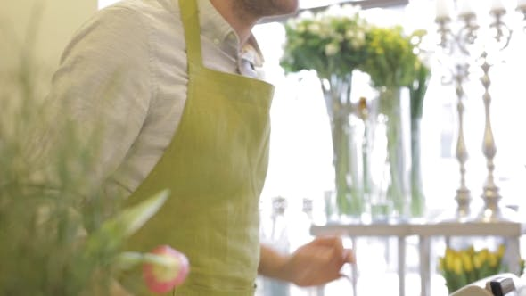 Thumbnail for Florist Showing Flowers To Customer At Flower Shop 22