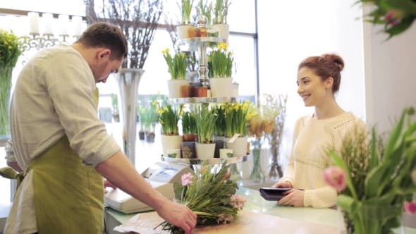 Cover Image for Florist And Woman Buying Flowers At Flower Shop 8