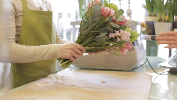 Thumbnail for Florist Wrapping Flowers In Paper At Flower Shop 16