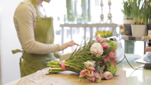 Thumbnail for Florist Woman With Flowers And Man At Flower Shop 17