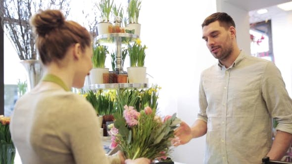 Thumbnail for Florist Woman With Flowers And Man At Flower Shop 3