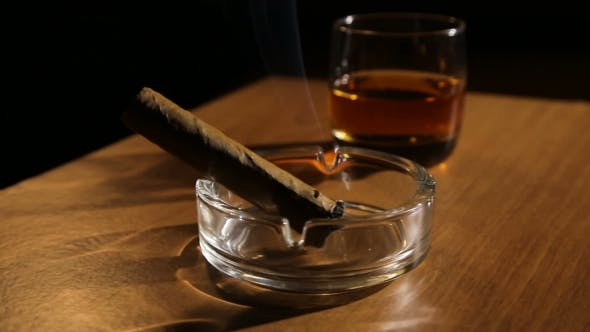Thumbnail for Whiskey Drinks With Smoking Cigars