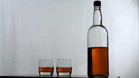Thumbnail for Glasses Of Whiskey With Bottle