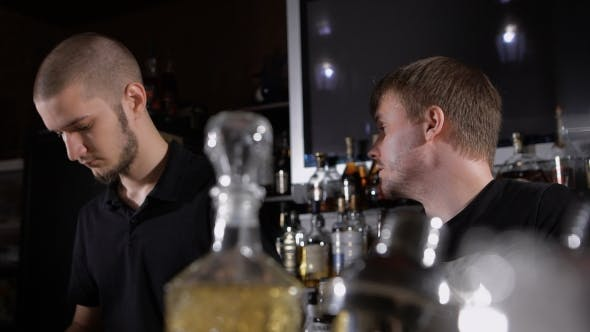Thumbnail for Bartenders At Work In The Club, Prepared Alcoholic Cocktails, Talk To Each Other.