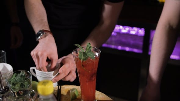 Thumbnail for Bartender Is Making Cocktail. Complex Preparation Of Various Ingredients