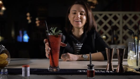 Thumbnail for The Bartender Makes An Exclusive Cocktail For The Attractive Brunette