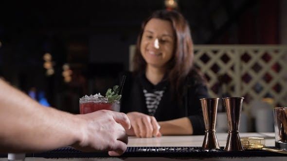 Thumbnail for The Bartender Puts An Exclusive Cocktail For The Attractive Brunette.