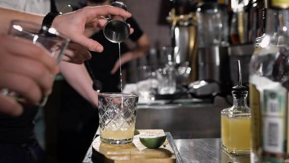 Thumbnail for Bartender Is Making Cocktail. Adding The First Ingredient Into The Glass