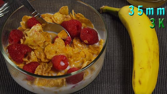 Cover Image for Breakfast Scene Top View Cereal Raspberry Banana
