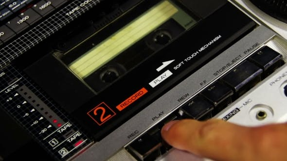 Thumbnail for Pressing a Finger Play And Stop Button On a Tape Recorder