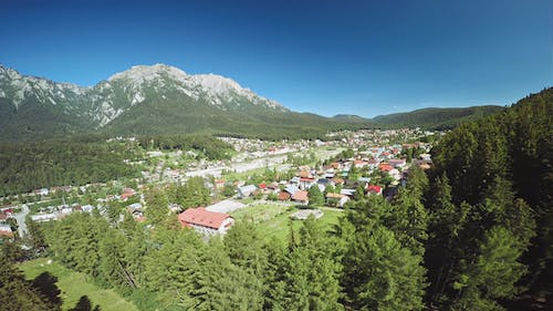 Town on the Foothills of Mountains and Forests