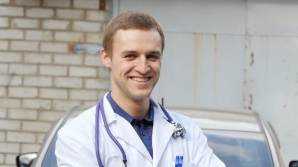 Thumbnail for Portrait Of Young Caucasian Medical Doctor Smiling Outdoor