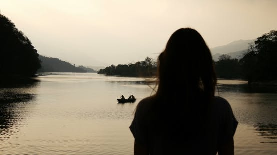 Thumbnail for Silhouette of a Girl on a Background of Lake And Boat