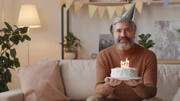 Thumbnail for Happy Middle-Aged Man With Birthday Cake
