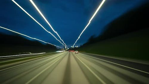 Driving on the night highway, time-lapse
