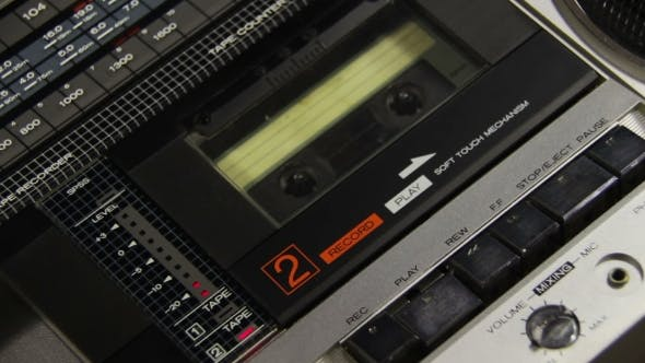 Thumbnail for Insert Audio Cassettes Into The Tape Player