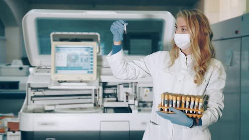 Portrait of a Lab Worker with Blood Sampling Tubes in Her Hands. Laboratory for the Study of