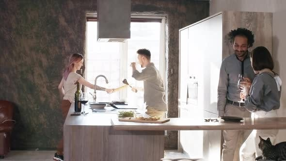 Thumbnail for Couple Having Fun and Chasing Each Other around Kitchen