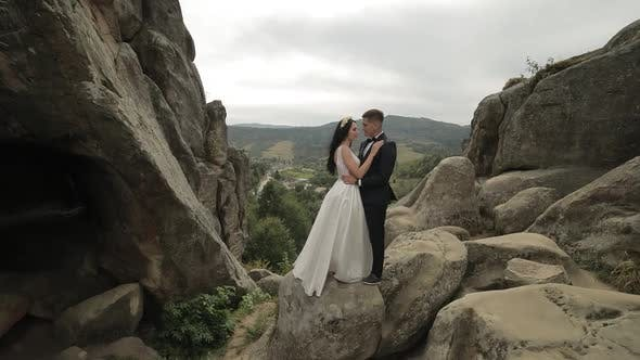 Thumbnail for Groom with Bride Standing on the Mountain Hills. Wedding Couple. Newlyweds