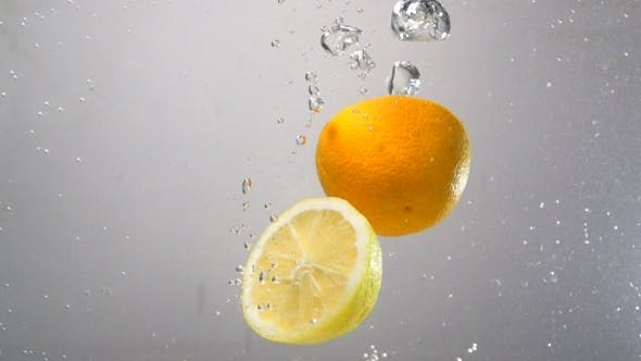 Thumbnail for Lemon And Orange Drops Into Water