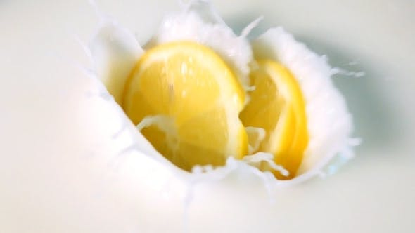 Thumbnail for Pieces Of Lemon Drops Into The Milk.