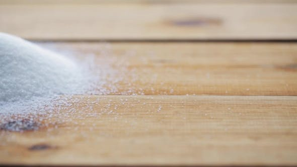 Thumbnail for White Sugar Pouring Into Heap On Wooden Table 52