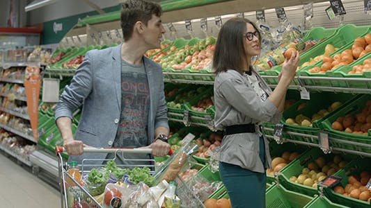 Thumbnail for Young Couple Buying Fruits