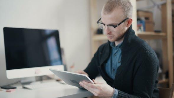Businessman Or Estate Agent Checking a Property Portfolio Online