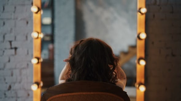 Thumbnail for Reflection Of Young Beautiful Woman Applying Her Make-Up