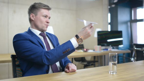 Cover Image for Businessman Holding Paper Plane, Thinking an Idea