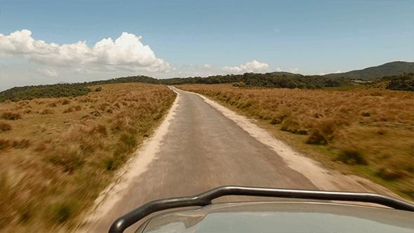 Thumbnail for Driving on a Rural Road Through Grass Plains