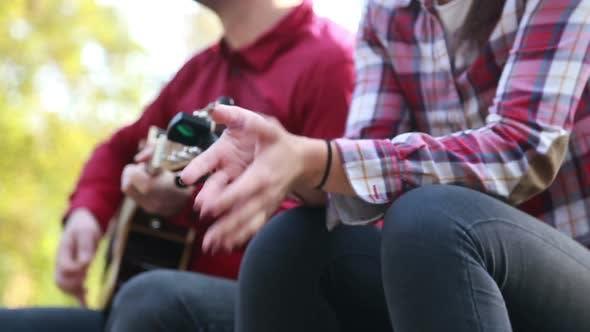 Thumbnail for Man Playing Guitar While Beautiful Woman Singing