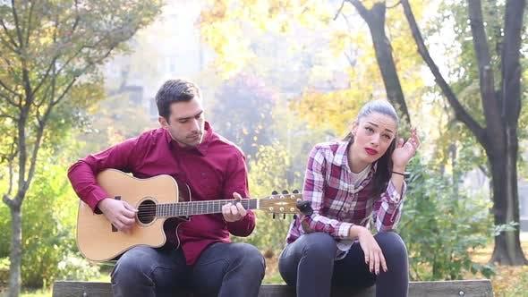 Thumbnail for Man Playing Guitar While Woman Singing 5