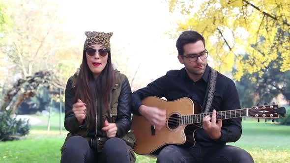 Thumbnail for Brunette Woman Singing While Handsome Man Playing Guitar 4
