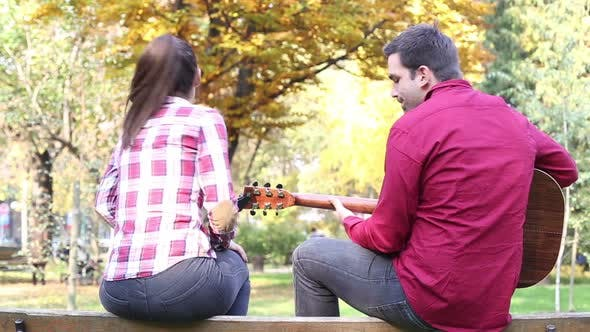 Thumbnail for Man Playing Guitar While Woman Singing In Park