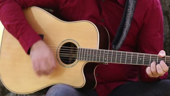 Thumbnail for Man Playing The Guitar