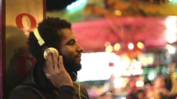 Thumbnail for Man Shaking His Head To The Rhythm Of Music With Headphones 2