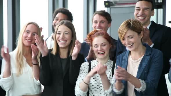 Thumbnail for Close Up Of Happy Business People, Laughing And Clapping