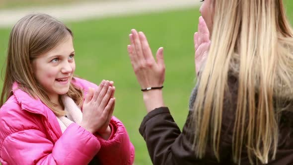 Thumbnail for Mom And Daughter Playing Clapping Game 1